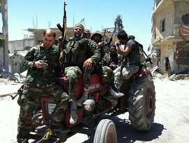 TOPSHOTS Syrian army's soldiers sit on a tractor holding their weapons on June 5, 2013 in the city of Qusayr in Syria's central Homs province, after the Syrian government forces seized total control of the city and the surrounding region. The Syrian army ousted rebels from the strategic town of Qusayr after a blistering 17-day assault led by Hezbollah fighters, scoring a major battlefield success in a war that has killed at least 94,000 people.   AFP PHOTO / STR-/AFP/Getty Images