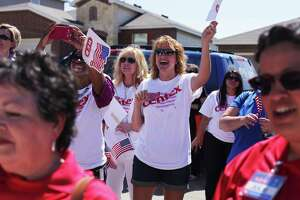 About two-hundred volunteers, HEB employees, and neighbors watched the Brown and McCrillis families walk into their new homes for the first time at the HEB Tournament of Champions Home giveaway on Wednesday, June 6, 2013 on Desert Ash near the TCP Parkway.