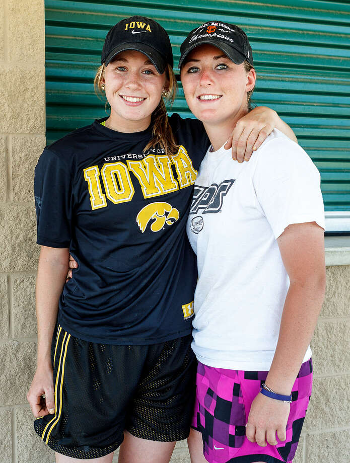 "Whitney ""Crash"" Repole (left) and her twin sister Katie ""Rip"" Repole pose for a photo during the Lone Ranger State Camp at the Jumbo Evans Field in Comal County."