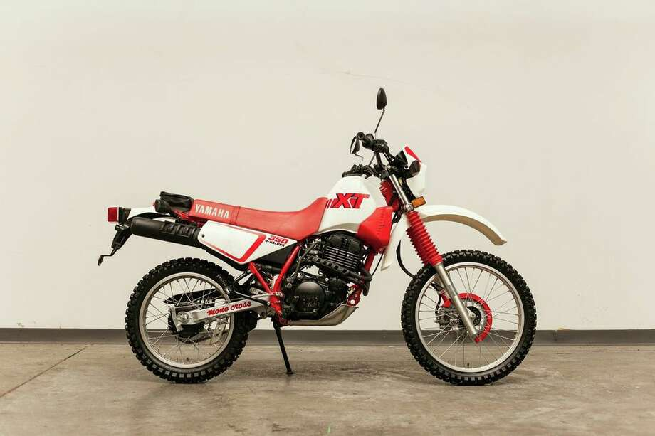 Bruce Willis has donated his 1991 Yamaha XT 350 dirt bike to Charitybuzz, an online auction website that raises money for non-profits. It'll benefit Boot Campaign, a Houston group that supports wounded veterans and their families. Photo: --