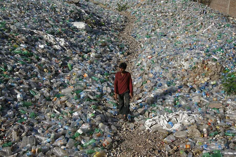 Used once, then discarded: Thousands of plastic bottles cover the ground in an industrial area of Jammu, India, on World Environment Day. Photo: Channi Anand, Associated Press
