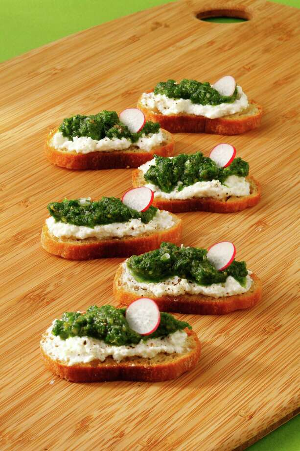This radish leaf pesto crostini incorporates radish leaves and peanuts. (Craig Lee/Special to The San Francisco Chronicle; Food styled by Lynne Char Bennett/The San Francisco Chronicle) Photo: Craig Lee / ONLINE_YES