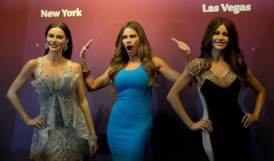 "Seeing double: Sofia Vergara of ""Modern Family"" hams it up as two Madame Tussauds wax figures of her are unveiled in New York. Photo: Don Emmert, AFP/Getty Images"