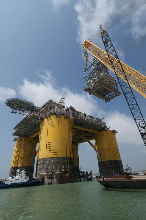 The 10-million-pound drilling structure was loaded onto a barge in Baytown and shipped  to Ingleside, where it was mated with the Olympus platform. Photo: Mike Duhon Productions, Shell