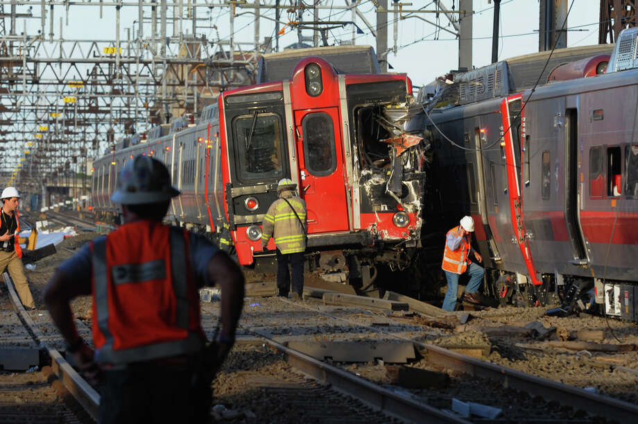 Two Metro-North Railroad trains collided and one derailed at 6:10 p.m. Friday, May 17, 2013 in the vicinity of Commerce Drive along the Fairfield-Bridgeport, Conn. line. Photo: Christian Abraham / Connecticut Post