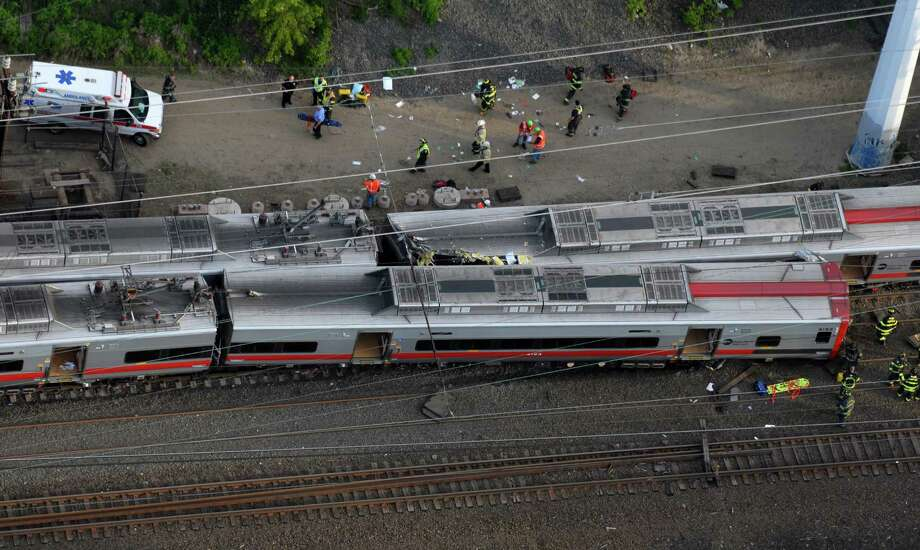 Morgan Kaolian/AEROPIX Two trains collided and one derailed shortly after 6 p.m. Friday May 17, 2013, in the vicinity of Commerce Drive along the Fairfield-Bridgeport line in Conn. Photo: Morgan Kaolian, Morgan Kaolian/AEROPIX / Connecticut Post Freelance
