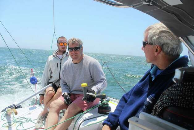 Greenwich resident Michael Millard has been busy preparing for the solo leg of the Bermuda One-Two Yacht Race, which begins tomorrow. Above, Millard, center, gets in some practice sailing off Newport last weekend with his son Ben, left, and his crewmate Bjorn Johnson,  who will join Millard on the return leg of the race. Photo: Contributed Photo