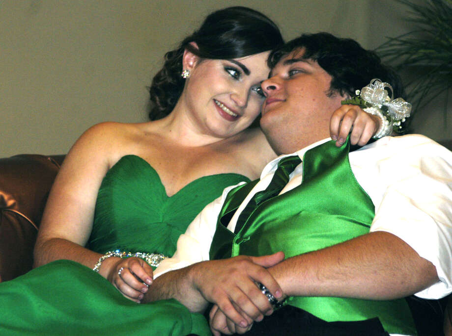 Melanie Wilbur and Josh Reutzel find a comfy spot for quiet time together during the Shepaug Valley High School prom, May 25, 2013 at the Heritage Inn in Southbury. Photo: Norm Cummings