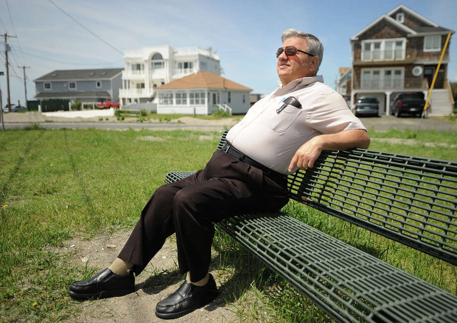 Bob MacDowell, of Shelton, relaxes on a sunny bench by the Seawall in Stratford, Conn. on Wednesday, June 5, 2013. Photo: Brian A. Pounds / Connecticut Post