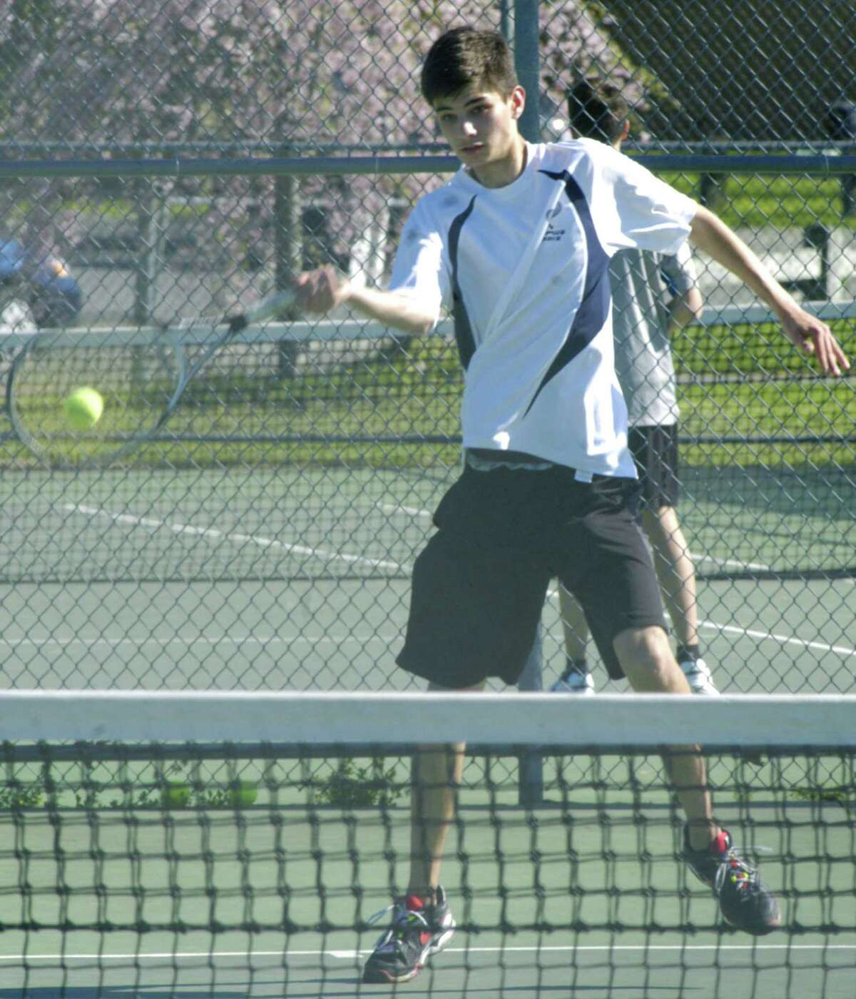 The Spartans' Kirby Peters employs his impressive reach to retrieve a rival's shot for Shepaug Valley High School boys' tennis. May 2013