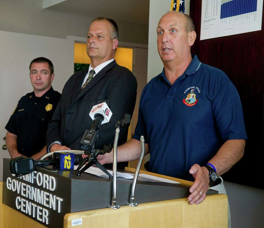 Police Chief Jon Fontneau stands with Assistant Chief Jim Matheny, far left, Public Safety Director Ted Jankowski, center, and Mayor Michael Pavia, not pictured, as he speaks during a press conference in which they spoke about crime statistics released by the FBI which rank Stamford as the 11th safest city in the country. Photo: Lindsay Perry / Stamford Advocate