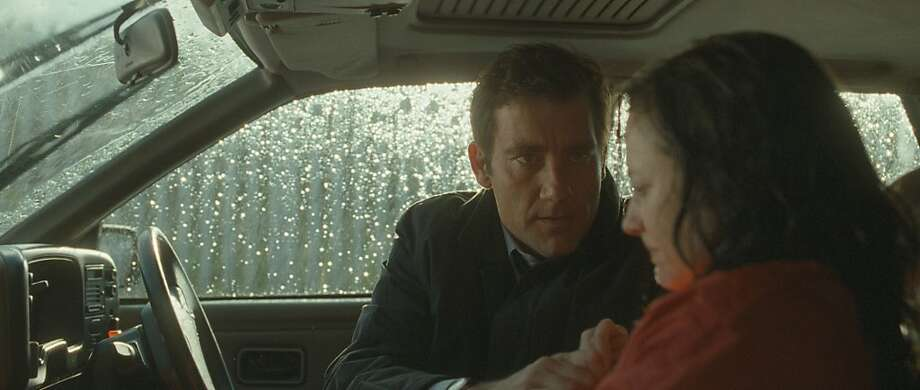 "Mac (Clive Owen) is the handler and Collette (Andrea Riseborough) the pawn in the Northern Ireland-set thriller ""Shadow Dancer,"" set mostly in 1993. Photo: Magnolia Pictures"