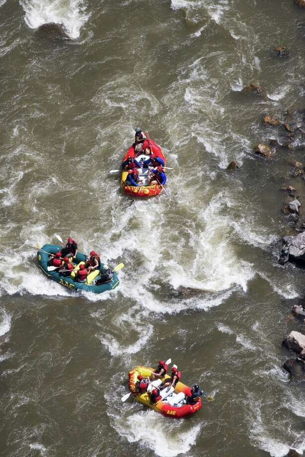 Clockwise from the left: Whitewater rafters on the Arkansas River in Colorado. The Springs Resort and Spa in Pagosa Springs. Great Sand Dunes National Park, with the Sangre de Cristo Mountains in the background, is a fun hiking experience near Alamosa. Photo: Unknown
