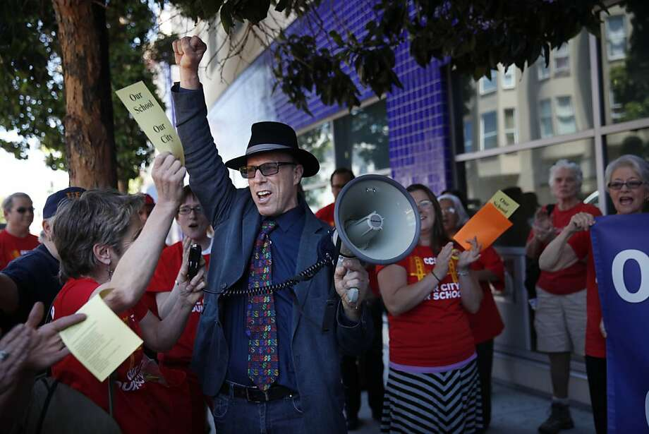 CCSF teacher Kathe Burck (left) and Ken Tray of United Educators of San Francisco at a May rally. Photo: Lea Suzuki, The Chronicle
