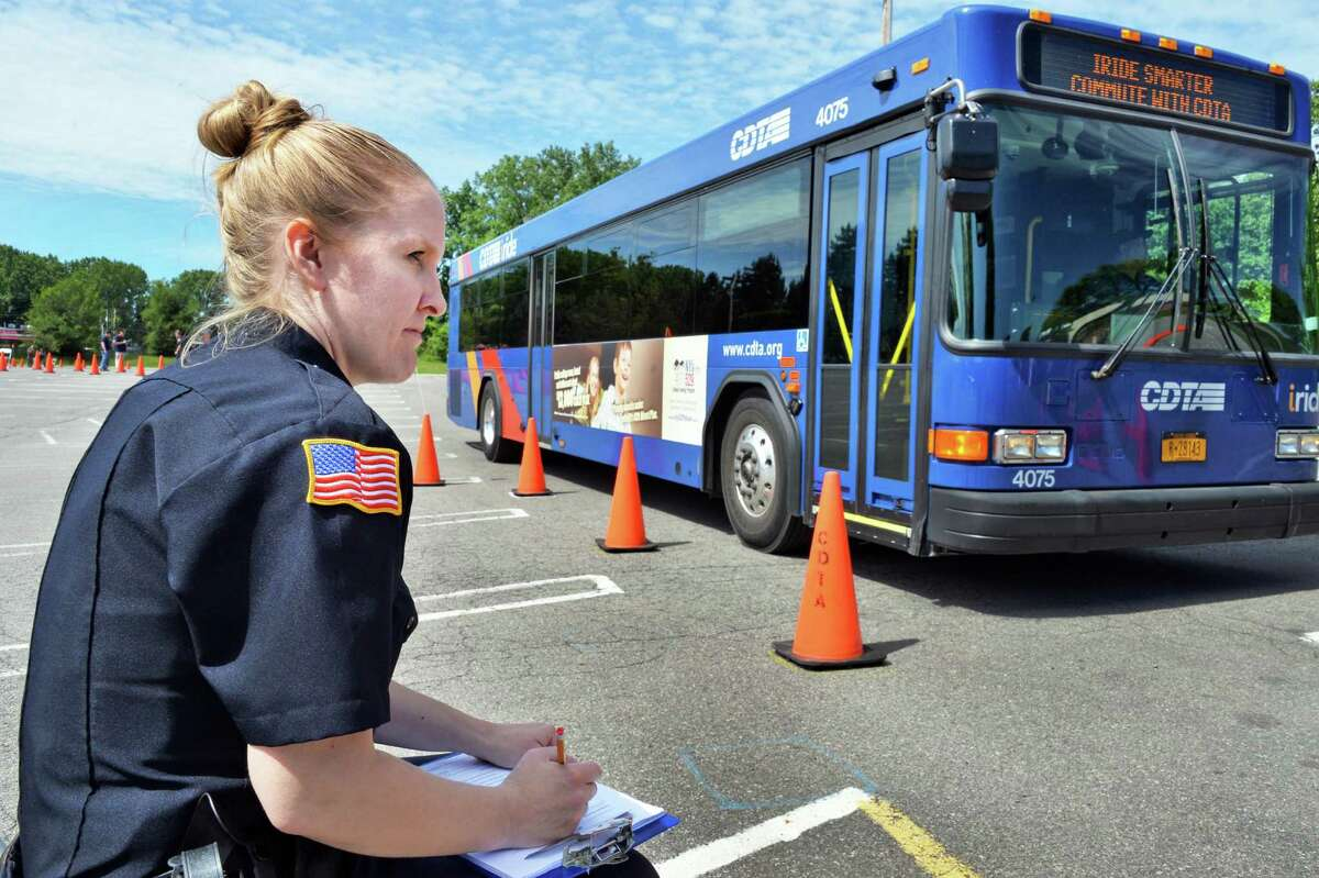 Green Island Police Officer Stacy McNally grades bus driver Andreas Astacio as he competes in the Championship CDTA Roadeo at the Crossgates Mall parking lot in Albany, NY, Wednesday June 5, 2013. (John Carl D'Annibale / Times Union)