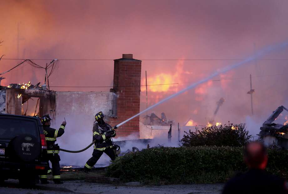 Fire fighters from around the Peninsula battled the blaze. A blast believed to be caused by a natural gas explosion destroyed a San Bruno, Calif. neighborhood Thursday September 9, 2010. Photo: Brant Ward, The Chronicle