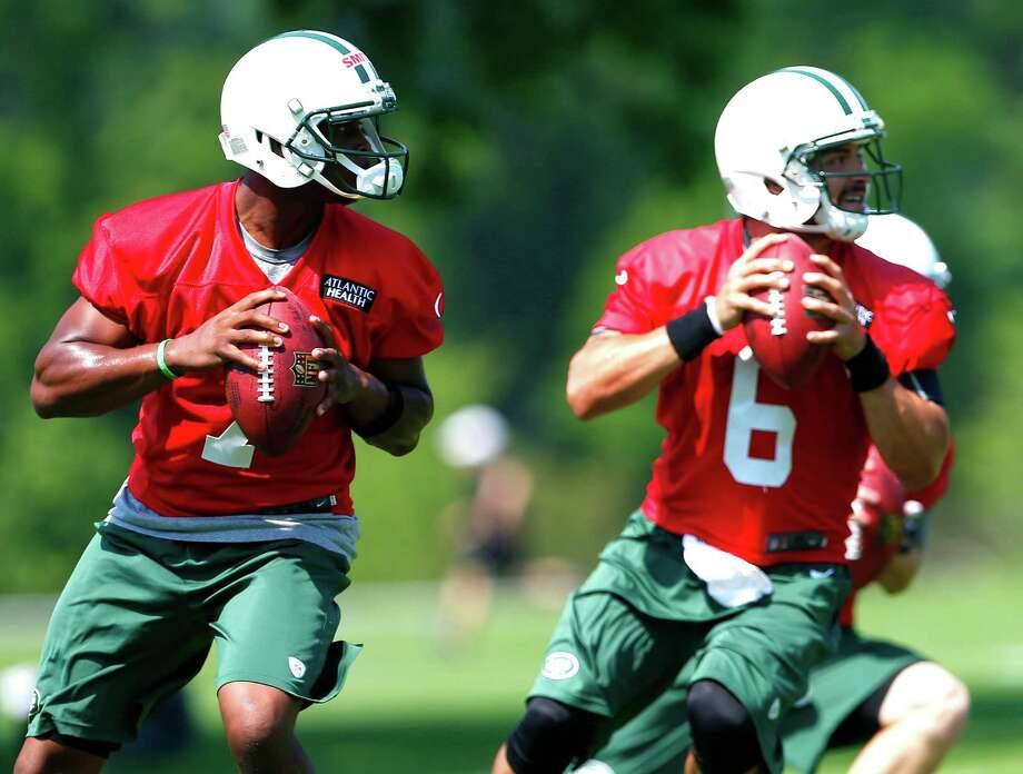 Who will lead the New York Jets offense this year - draft pick Geno Smith, left, or returning quarterback Mark Sanchez? For Jet fans it's a coin toss - heads you win, tails I lose.  (AP Photo/Rich Schultz) Photo: Rich Schultz, Associated Press / FR27227 AP