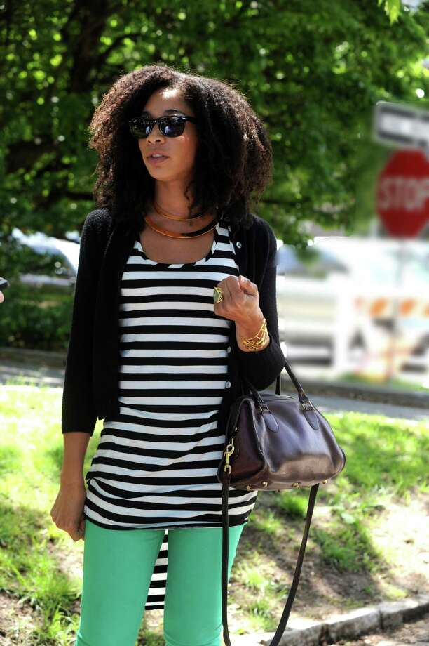 Mallory Mason, of Greenwich, was taking a walk on Greenwich Avenue on Wednesday, June 5, 2013. Mason was wearing striped black and white shirt with fish tail cut (Target) and a black light cotton cardigan (thrift store), bright green skinny pants (H&M.) Photo: Helen Neafsey / Greenwich Time