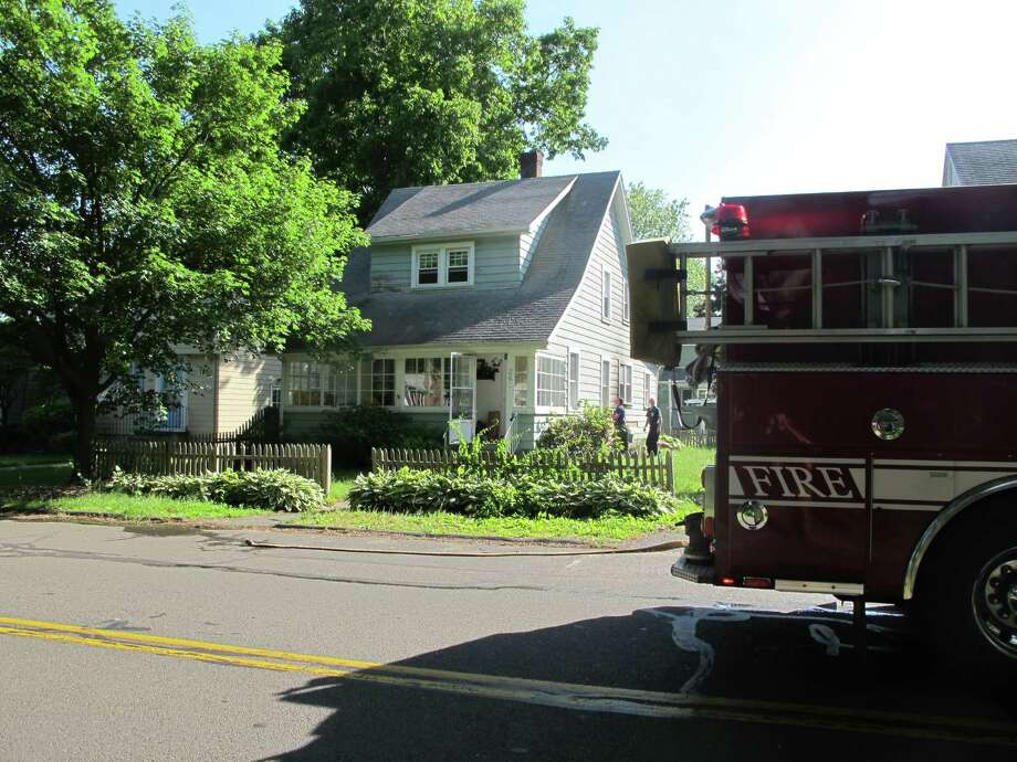 Authorities credited a passerby's 911 call and a nearby fire company's quick response with limiting a fire in a Church Hill Road home to a small portion of the structure Wednesday afternoon. Photo: Denis O'Malley / Connecticut Post