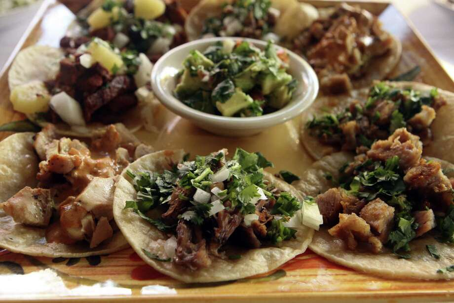 An array of tacos is served on the Botana Mexicana plate at SoLuna. Photo: Express-News File Photo