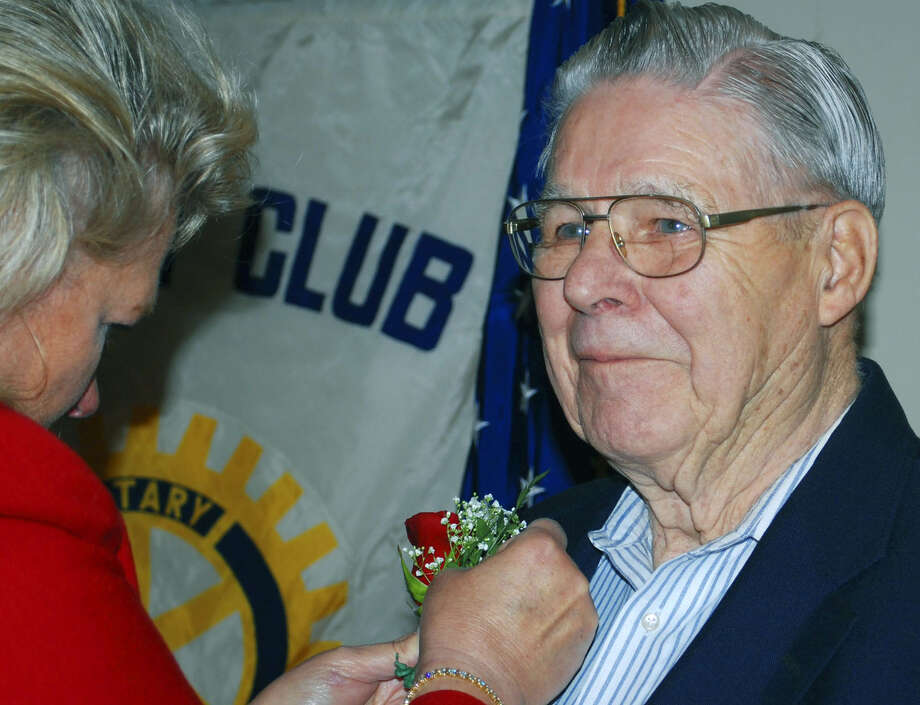 Andy Armstrong, one of the founders of the New Milford Rotary Club 50 years ago, proudly accepts a boutonniere from fellow Rotarian Katy Francis on Jan. 12, 2010. Andy Armstrong died June 4, 2013 at the age of 87. Photo: Deborah Rose