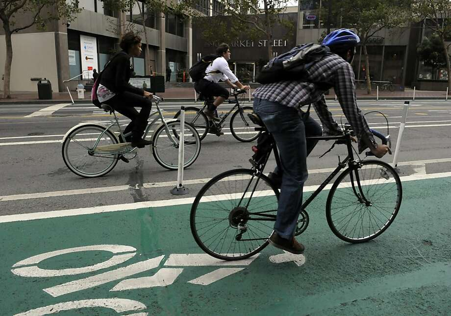 Bicyclists on Market Street should have fewer potholes to dodge after a repaving project this weekend between Van Ness Avenue and Sixth Street. Photo: Adm Golub, The Chronicle
