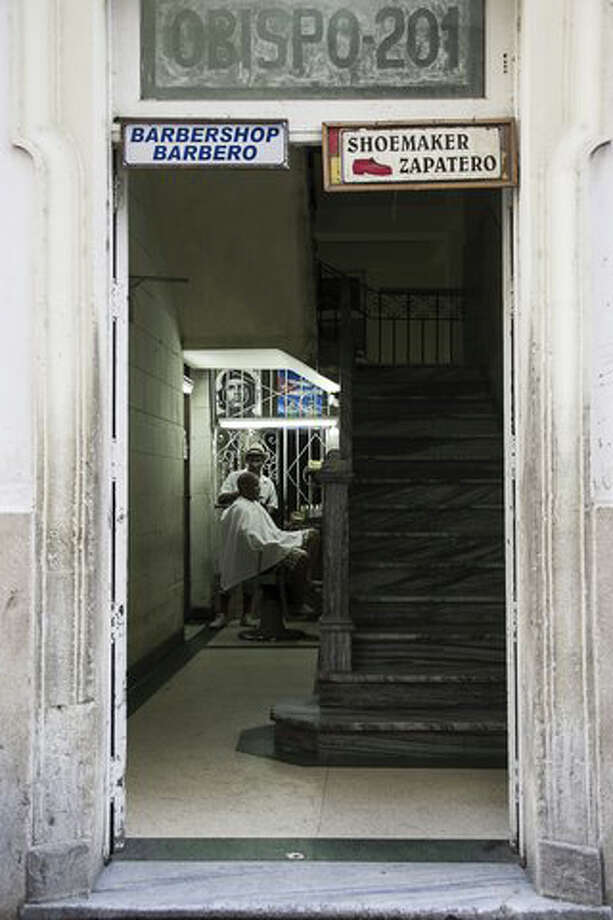 New Milford author and photographer Rich Pomerantz captured this picture of a small barber shop in Havana, Cuba. Photo: Contributed Photo