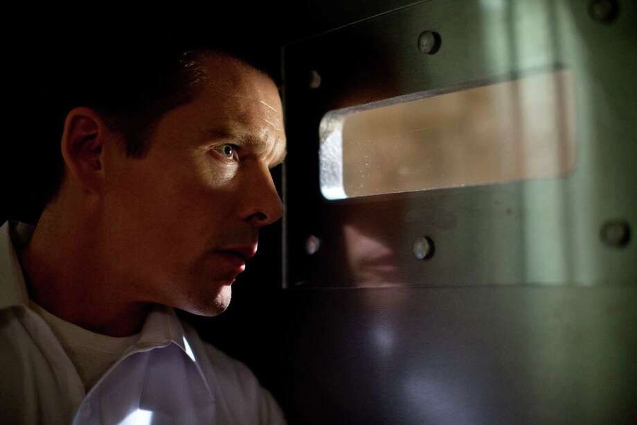 "Ethan Hawke plays a security-conscious dad in the unusual thriller ""The Purge."" Photo: Daniel Mcfadden / Associated Press"