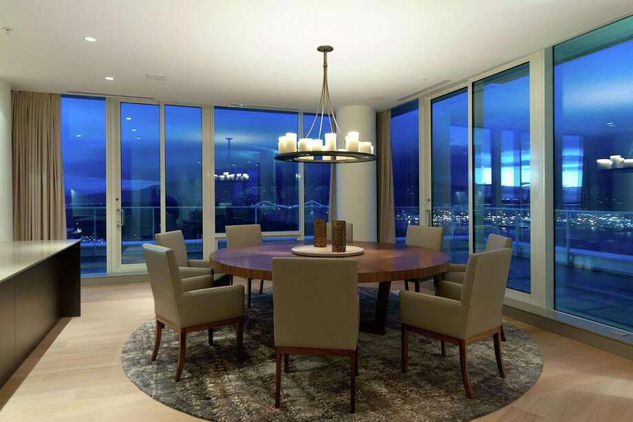 Dining room of Penthouse One at The Fairmont Estates Pacific Rim, 1011 W.Cordova St., in Vancouver, B.C. The 6,459-square-foot, two level condo just sold for a record $25 million. Photo: Stacy Thomas,  Courtesy Malcolm Hasman