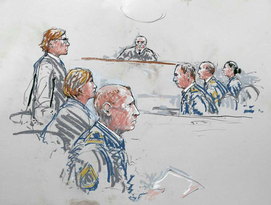 In this courtroom sketch, U.S. Army Staff Sgt. Robert Bales, third from front left, sits with his civilian attorneys, John Henry Browne, left, and Emma Scanlan, second from left, Wednesday, June 5, 2013 as they appear before military judge Col. Jeffery Nance, center, and the military's prosecution team at right, during a plea hearing in a military courtroom at Joint Base Lewis McChord in Washington state. Bales pleaded guilty to multiple counts of murder, stemming from a pre-dawn attack on two villages in Kandahar Province in Afghanistan in March, 2012. (AP Photo/Peter Millett) Photo: Peter Millett, FRE / FR 83599 AP