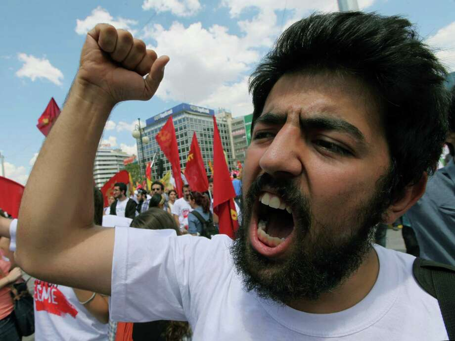 A protester shouts Wednesday in support of trade unionists marching in Ankara, a sign of growing resistance to Prime Minister Recep Tayyip Erdogan. Photo: Burhan Ozbilici, STF / AP