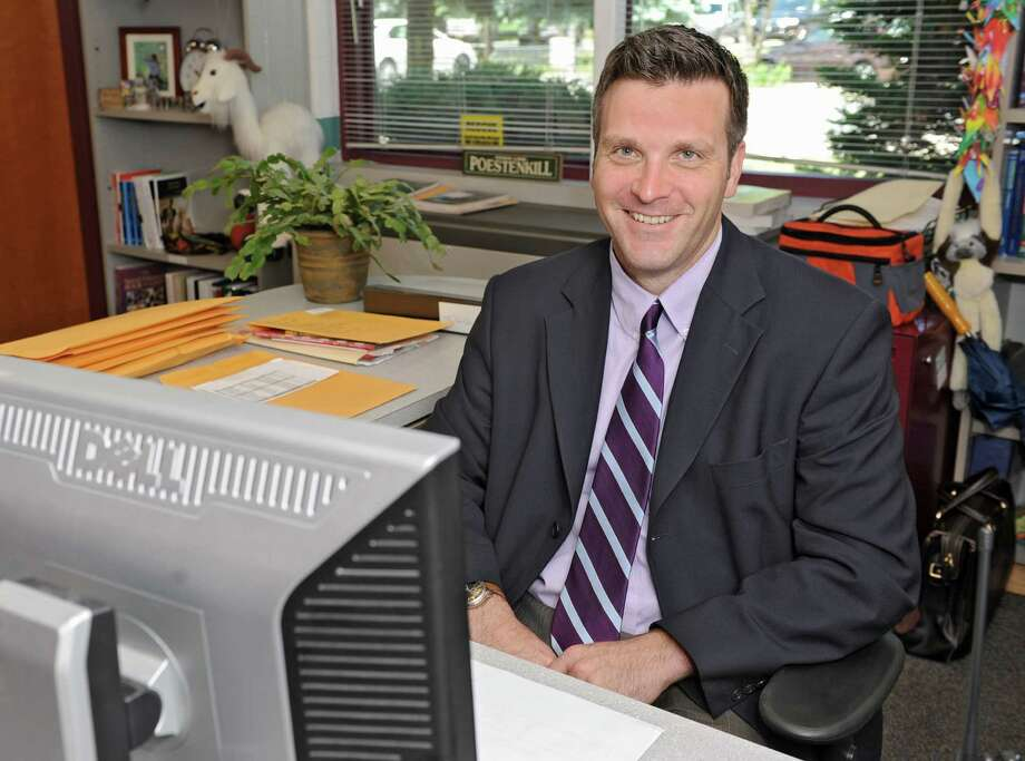 Poestenkill Elementary School principal Peter DeWitt sits in his office on Wednesday, June 5, 2013 in Poestenkill, N.Y. DeWitt talked to us about field tests given to New York's students on behalf of the Pearson testing company.  (Lori Van Buren / Times Union) Photo: Lori Van Buren / 00022710A