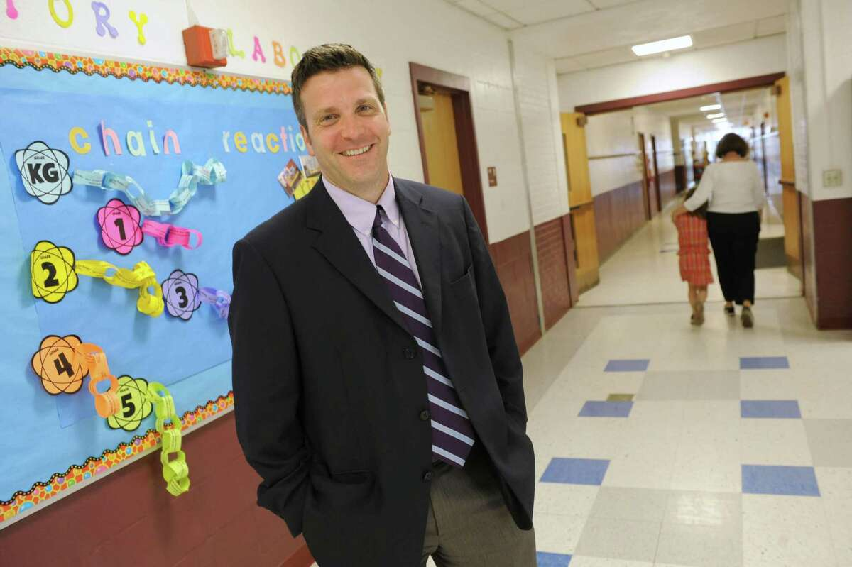 Poestenkill Elementary School principal Peter DeWitt stands in a hallway on Wednesday, June 5, 2013 in Poestenkill, N.Y. DeWitt talked to us about field tests given to New York's students on behalf of the Pearson testing company. (Lori Van Buren / Times Union)