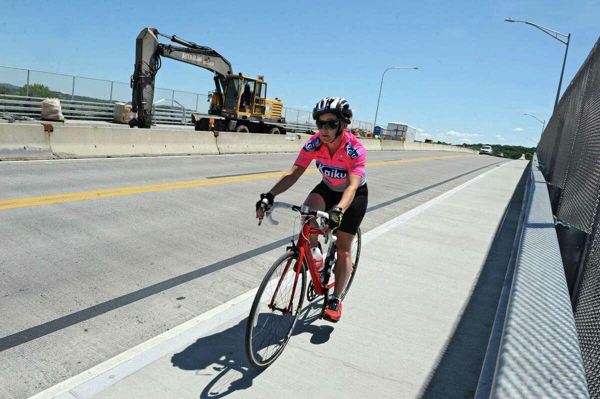 A woman ride her bike across the Congress Street bridge on Wednesday, June 5, 2013 in Troy N.Y. (Lori Van Buren / Times Union)