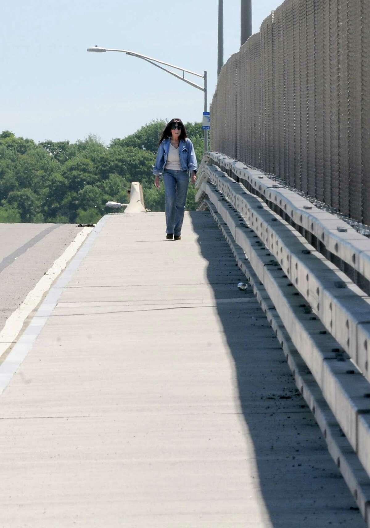 A pedestrian walks on the Congress Street bridge on Wednesday, June 5, 2013 in Troy N.Y. (Lori Van Buren / Times Union)