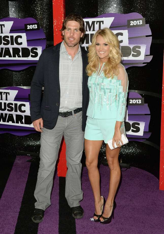 NASHVILLE, TN - JUNE 05:  Singer Carrie Underwood (R) and  Mike Fisher attend the 2013 CMT Music awards at the Bridgestone Arena on June 5, 2013 in Nashville, Tennessee.  (Photo by Jason Merritt/Getty Images)