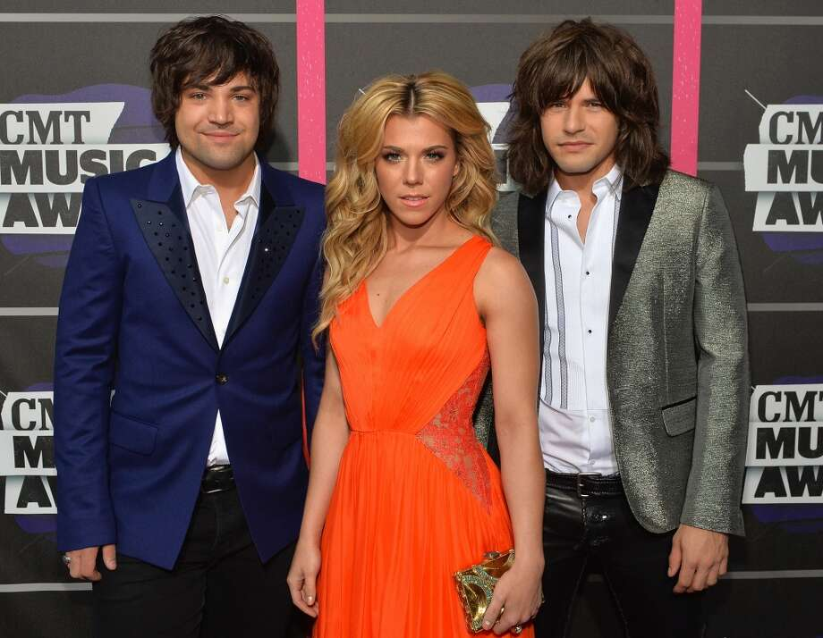 NASHVILLE, TN - JUNE 05:  (L-R) Musicians Neil Perry, Kimberly Perry and Reid Perry of The Band Perry attend the 2013 CMT Music awards at the Bridgestone Arena on June 5, 2013 in Nashville, Tennessee.  (Photo by Rick Diamond/Getty Images)