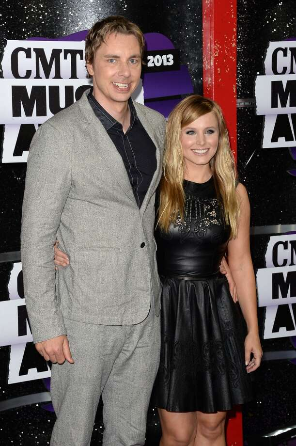 NASHVILLE, TN - JUNE 05:  Host Kristen Bell (R) and actor Dax Shepard attend the 2013 CMT Music awards at the Bridgestone Arena on June 5, 2013 in Nashville, Tennessee.  (Photo by Jason Merritt/Getty Images)