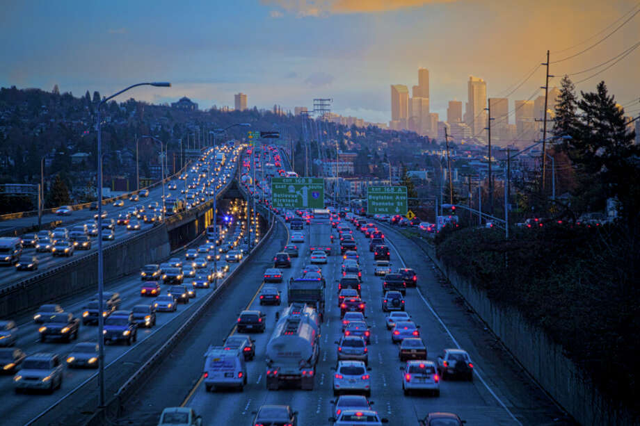 We get out of a freeway lane a mile before the first sign that says the lane will eventually end, then get mad at anyone still in the lane. Photo: Mel Curtis, Getty Images / (c) Mel Curtis