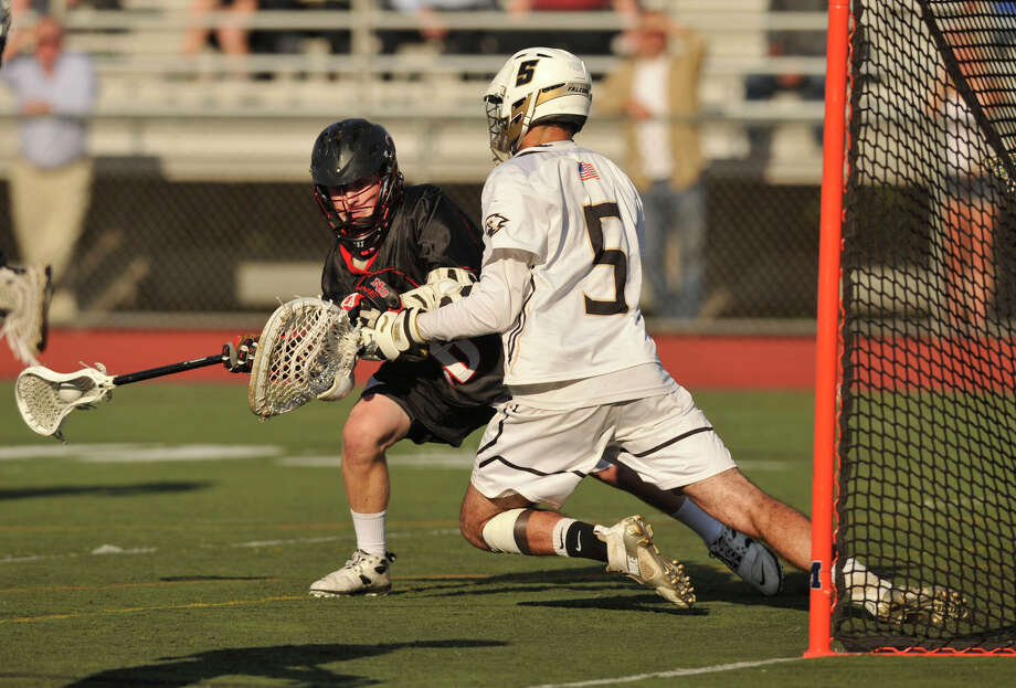 New Canaan's Henry Stanton shoots and scores on Joel Barlow goalie Cooper Brown during their Class M semifinal game at Brien McMahon High School in Norwalk on Wednesday, June 5, 2013. Joel Barlow won 5-4 in overtime. Photo: Jason Rearick / Stamford Advocate