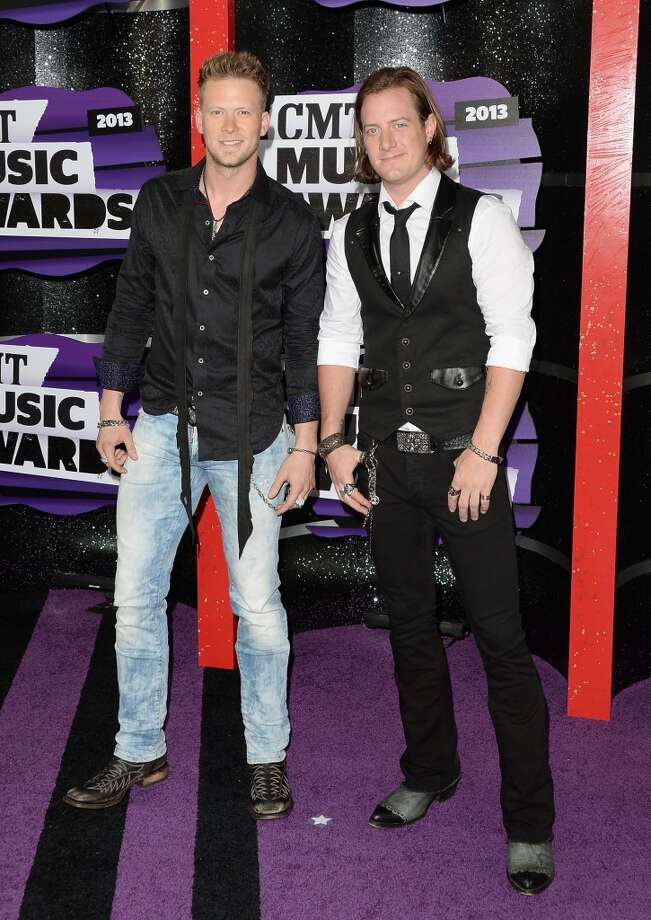 NASHVILLE, TN - JUNE 05:  (L-R) Musicians Brian Kelley and Tyler Hubbard of Florida Georgia Line attend the 2013 CMT Music awards at the Bridgestone Arena on June 5, 2013 in Nashville, Tennessee.  (Photo by Jason Merritt/Getty Images)