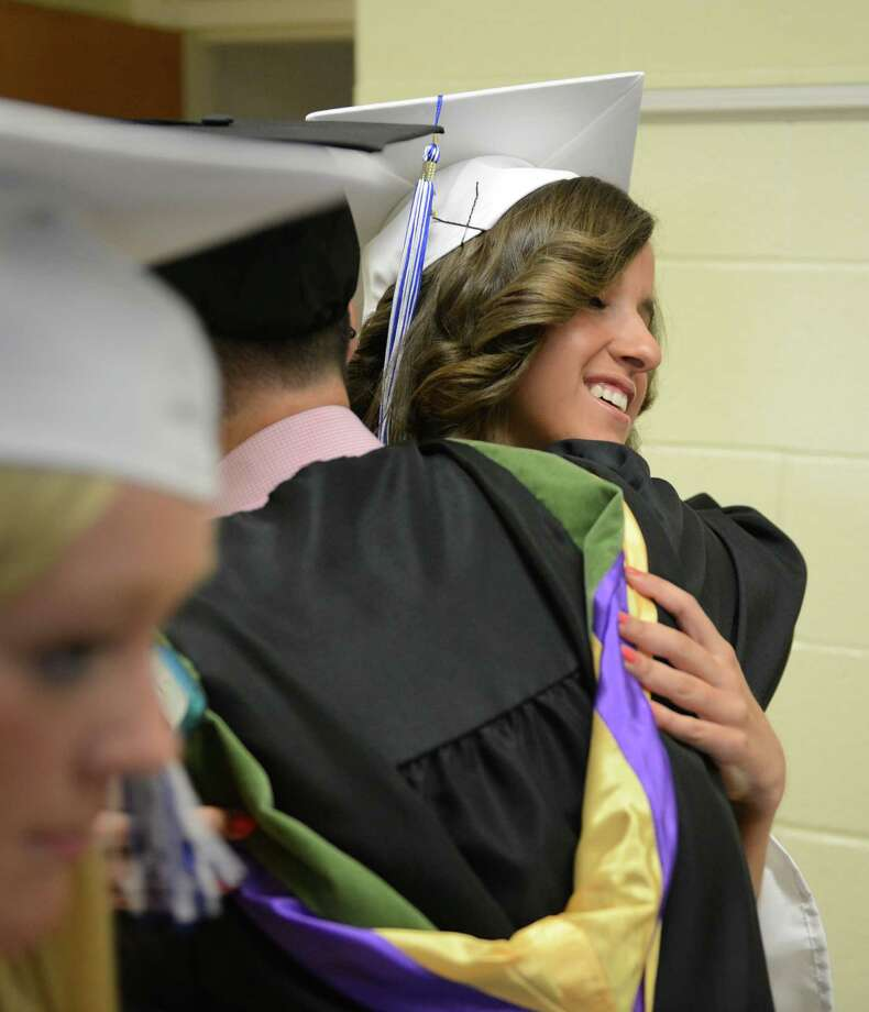 Jena Mazzucco, right, hugs Alex Esposito before the Immaculate High School graduation at St. Mary's Church in Bethel, Conn. on Wednesday, June 5, 2013. Photo: Tyler Sizemore / The News-Times