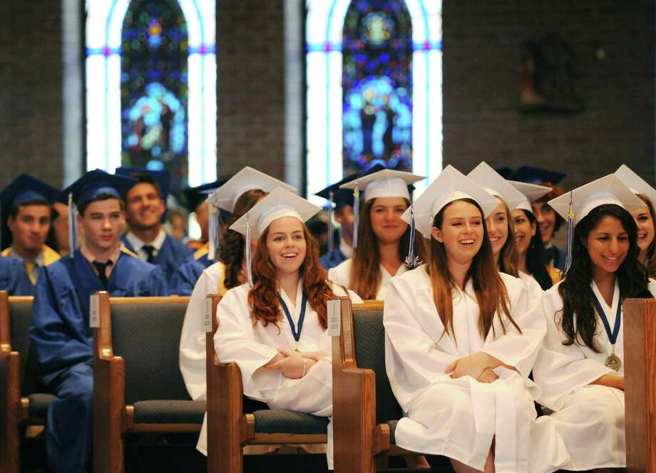 Immaculate High School students laugh during the commencement ceremony, which graduated 69 students, at St. Mary's Church in Bethel, Conn. on Wednesday, June 5, 2013. Photo: Tyler Sizemore / The News-Times