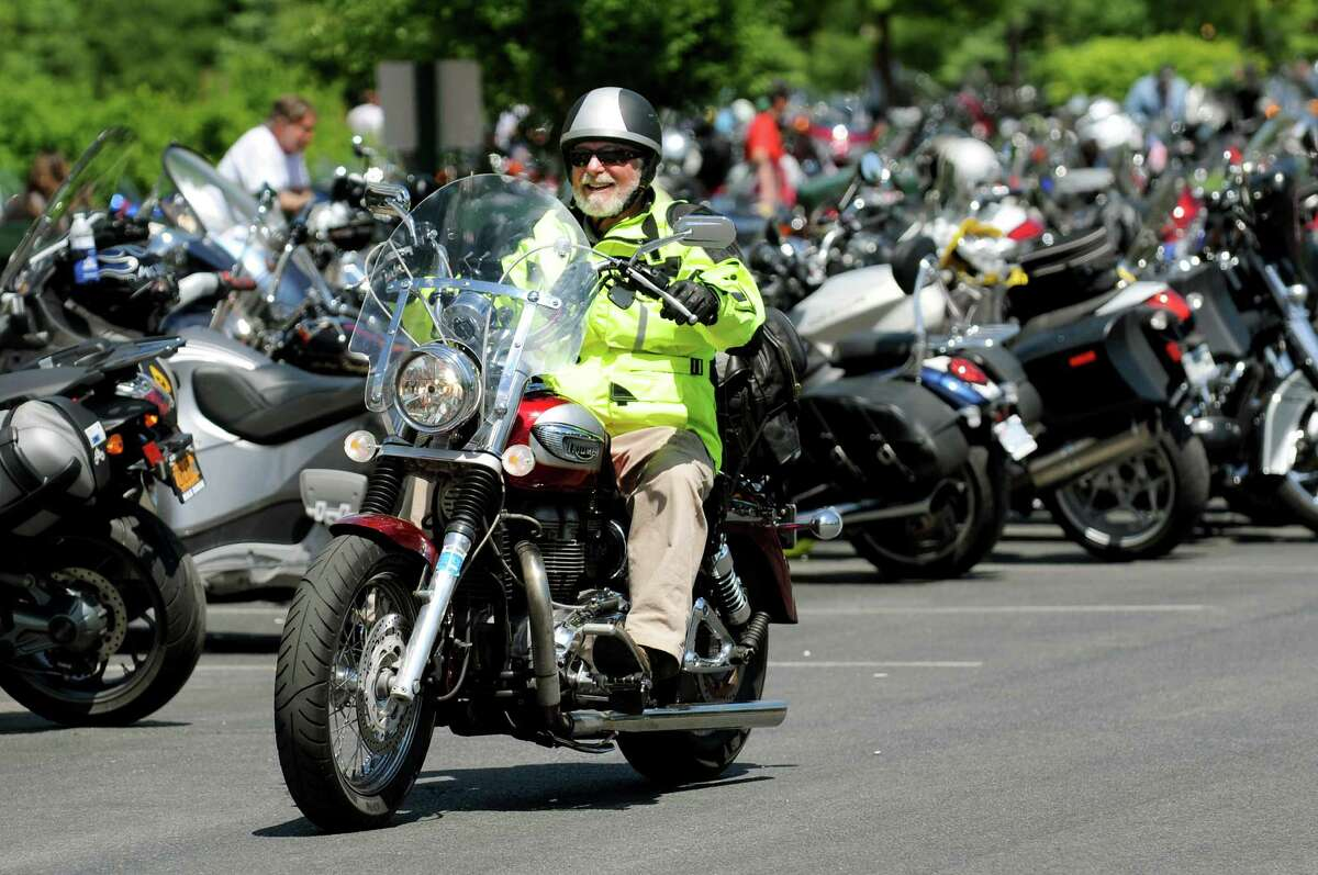 A motorcycle enthusiast rides on Wednesday, June 5, 2013, in Lake George, N.Y. (Cindy Schultz / Times Union)