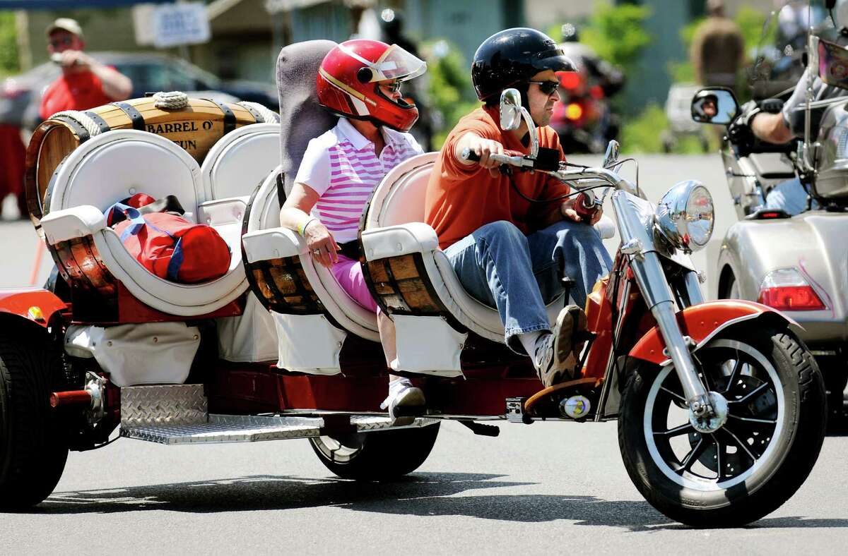 Stephane Legault of Ottawa, Canada and his mother, Jeannine Legault, ride his custom-made Barrel O' Fun motorcycle on Wednesday, June 5, 2013, in Lake George, N.Y. The four-seater is made from a Volkswagon chassis. (Cindy Schultz / Times Union)
