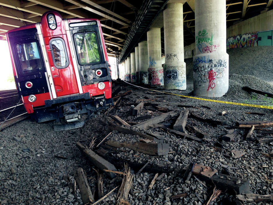 One of the Metro North trains involved in the May 17, 2013, accident sits at the end of the tracks. Photo: Contributed Photo\City Of Bridge, City Of Bridgeport/Adam Wood / Connecticut Post contributed