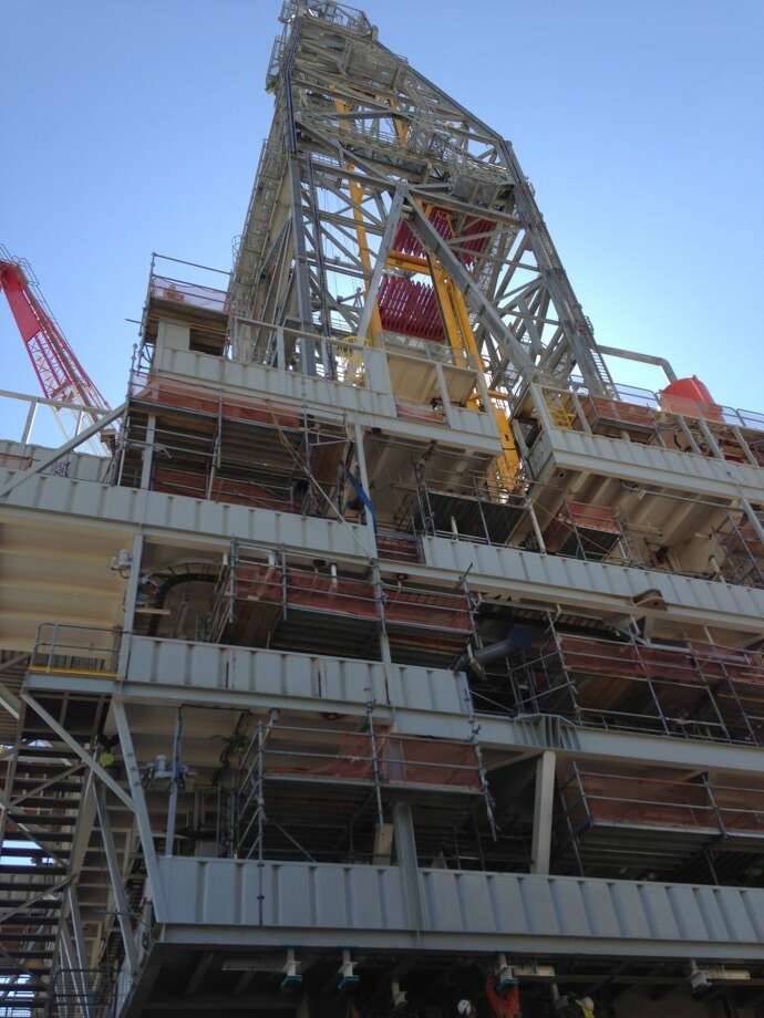 The derrick rises above the Shell Olympus hull. Photo: Emily Pickrell, Houston Chronicle