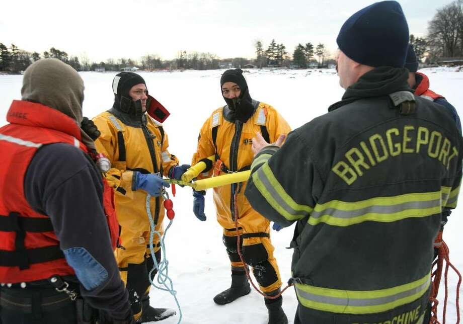 Bridgeport firefighters wear special  drysuits during ice rescue training drills at Lake Forest in Bridgeport, Conn on Wednesday, January 13, 2010. From left are engineer Richard Messer, firefighters Jim Bonosconi and Christian Teague, and Lt. Kenneth Domschine. Photo: Brian A. Pounds / Connecticut Post