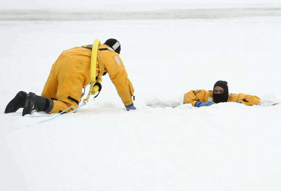 Bridgeport Fire ice rescue drills, Lake Forest in Bridgeport, Conn on Wednesday, January 13, 2010. Photo: Brian A. Pounds / Connecticut Post