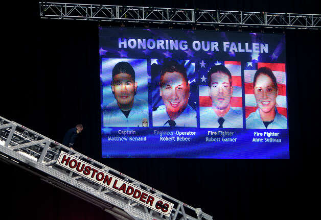 The photos of four fallen firefighters are seen before a memorial service in their honor at Reliant Stadium Wednesday, June 5, 2013. In Houston. Four firefighters died when a part of a building collapsed on them while they were searching for people they thought might be trapped inside a burning motel and restaurant last Friday. Photo: Cody Duty, Houston Chronicle / © 2013 Houston Chronicle